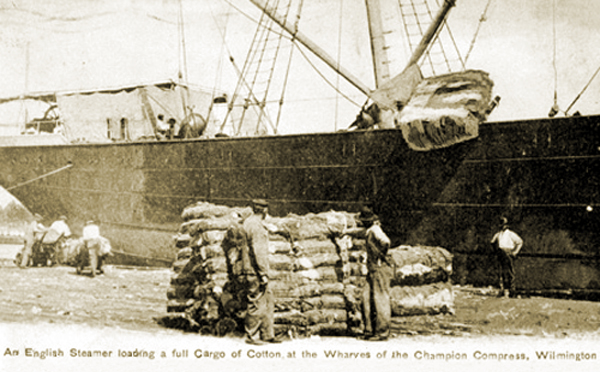 Champion Compress & Warehouse Company - An English Steamer loading a full cargo of cotton at the wharves. Wilmington NC