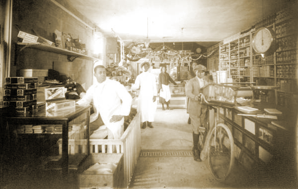 Another Interior View of the Palace Market. Frank Butler is on left, in white.