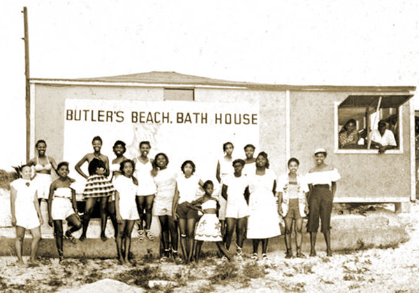 Beach-goers assembled for a group portrait by the bath house at Butler Beach, c.1950s